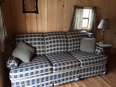 couch in cindy bear™ rustic cabin
